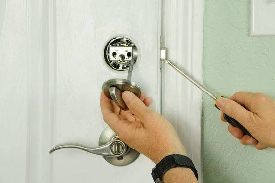 locksmith working on a residential lock